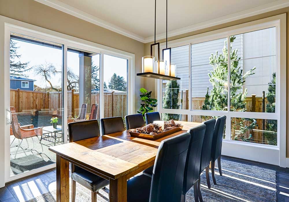 Custom exterior sliding door opening up to the back yard with a view of the beautiful kitchen looking out to their nicely landscaped back yard.