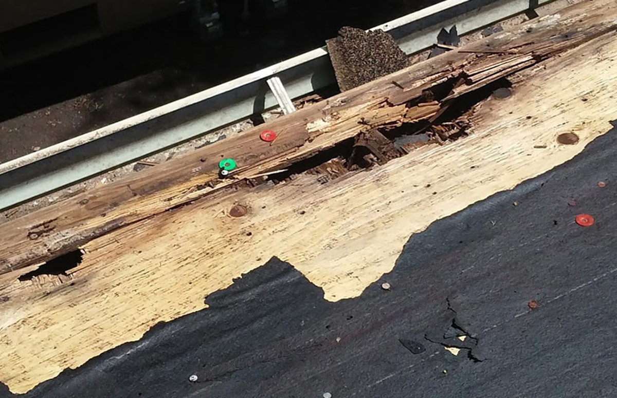 Storm damaged roof that is in desperate need of a roofing contractor