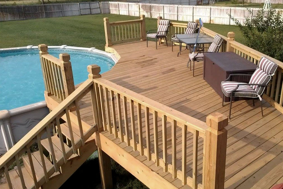 Custom built wood deck fitted around an above ground swimming pool